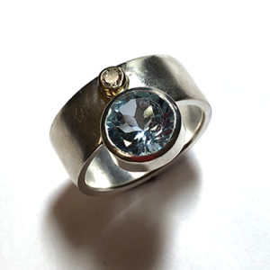 Swiss Blue Topaz Ring with Tubeset Diamond